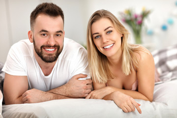 Adult attractive couple in bed