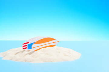 Active recreation background. Three surfboards on a sandy island, copy space