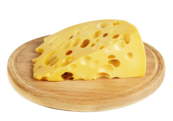 a piece of cheese with large holes lies on the board