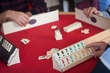 People play  popular logic table game rummikub