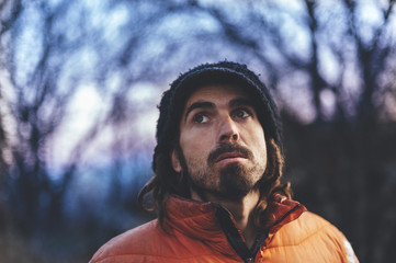Portrait of climber in the forest at dusk after climbing day