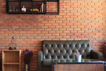 Vintage room with sofa set brick wall background.