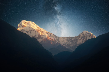 Night landscape on early morning. Starry sky with over the mountains
