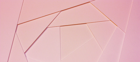 Abstract geometric background in light pastel tones from sheets of thick pale pink paper, cardboard. Wall mural