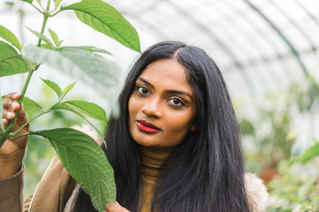 Pretty Indian woman posing with leaf