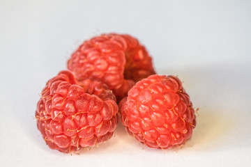 Macro photo of raspberries fruit. Rich in vitamins, antioxidants, and fiber, raspberries are a delicious fruit with many health benefits.