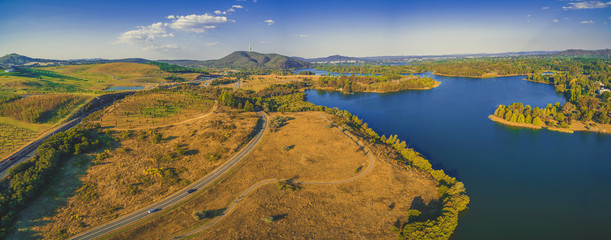 Aerial panorama of scenic Lake Burley Griffin in Canberra at sunset
