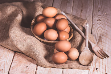 eggs in basket on wooden table