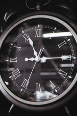 Vintage roman clock face close up. Clock hand close up, time concept.