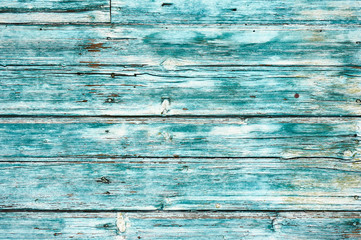 Old wooden background colored blue paint.