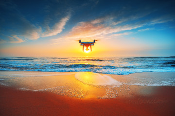 Beautiful morning over the sea and flying drone Wall mural