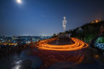 Meditation place of cycle candle lit with buddha image at Makha Bucha Day