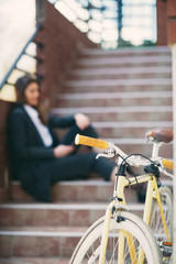 Selective focus on yellow bicycle on foreground.