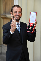 Ringo Starr, whose real name is Richard Starkey, poses after receiving his Knighthood at an Investiture ceremony at Buckingham palace in London