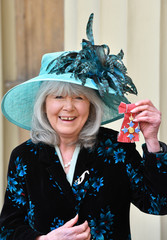 Author Jilly Cooper poses after she was awarded her Commander of the British Empire (CBE) medal during an Investiture ceremony at Buckingham Palace, London