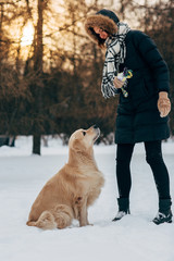Image of female with labrador in winter park for walk