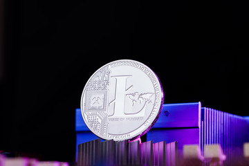 Picture of litecoin and processor on pink background