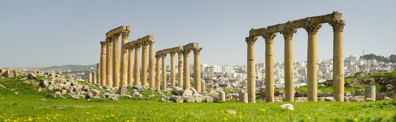 ruins of old columns on the green hill in Jordan