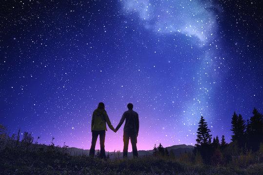 Way stars in mountain landscape
