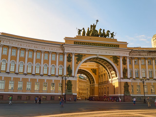 People next to the Arch of the General Staff in Saint Petersburg, Russia