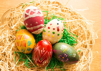 In the wicker basket are colorful easter eggs