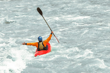 Kayaker having fun in white water rapids,  with copy space