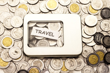travel in small paper onpile of money
