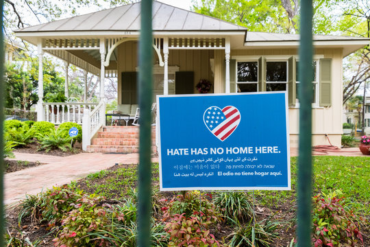 Hate Has No Home Here Sign in Front Yard of Home.