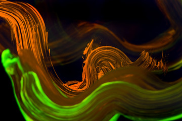 Abstract paint brush on the clear glass with light from neon.