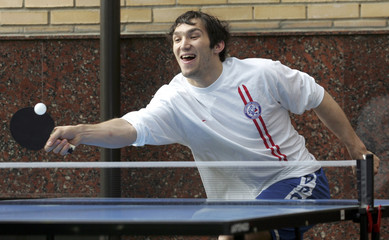 Alexander Ovechkin plays table tennis at Russia's national hockey team base in Moscow