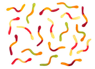 Colorful sweet gummy worms background isolated on white, close up, top view.