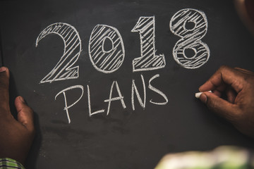 year 2018 written on black chalkboard with chalk visible