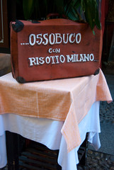Traditional dish of Milan - typical Italian food exposed outside a restaurant