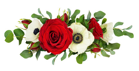 Red rose, anemone flowers and eucalyptus leaves in a line arrangement