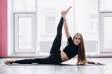 Woman doing yoga fitness exercise and stretching for relax and healthy