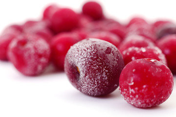 Group of frozen cherries.