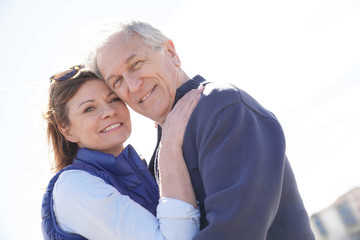 Portrait of senior couple embracing by the beach