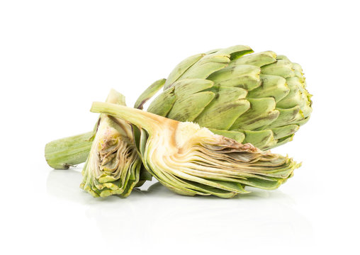 Globe artichoke set isolated on white background one raw head and two fresh cut slices.