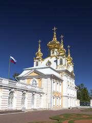 Saint Petersburg, PETERHOF, Russia. Palace church of Saint Peter and Paul in Peterhof Grand Palace. Clear blue sky.