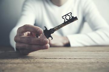 man hand key