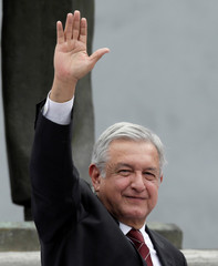 Leftist front-runner, Andres Manuel Lopez Obrador waves to supporters after his register as presidential candidate of the National Regeneration Movement (MORENA) in Mexico City