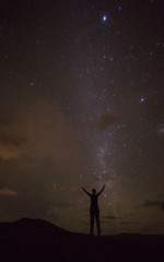 shilouette under the milky way, concept for power, success, travel, dream big