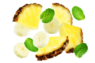 Flying Pineapple and banana slices with mint leaves