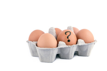 Close-up view of raw chicken eggs with question mark in box on white background.