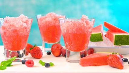 Preparing Summertime refreshing Watermelon granita desserts on a blue and white background.