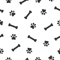 Dog or cat paw and bone seamless pattern. Animals paw print