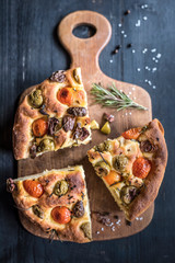 Slices of homemade Italian Focaccia with olives and tomatoes,selective focus