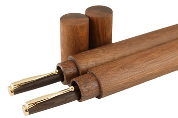 Wooden ball pen with a tube for storage on a white background