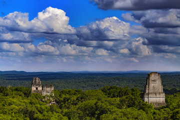 Guatemala. Tikal National Park (UNESCO World Heritage Site since 1979). Amazing view from the top of the Temple IV on surrounding jungle and the tops of pyramids(Temples I, II and III)