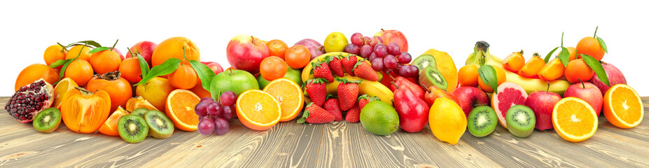 Assorted fruits and vegetables on wooden table isolated on white